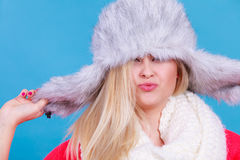 Blonde woman in winter warm furry hat Stock Photos