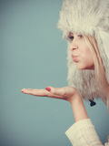 Blonde woman in winter warm furry hat Royalty Free Stock Photography
