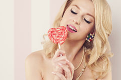 Free Blonde Woman With Lollipop Royalty Free Stock Photos - 36771168
