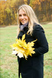 Blonde Woman With Maple Leaves Royalty Free Stock Images