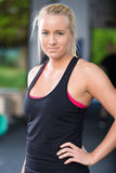 Blonde woman in workout outfit at the fitness gym Royalty Free Stock Images