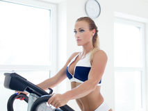 Blonde woman workout on treadmill Royalty Free Stock Images