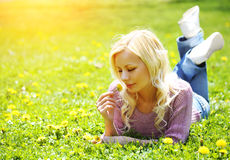 Blonde woman with Yellow Dandelion Flower Royalty Free Stock Photos