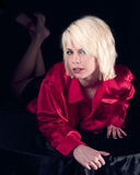 Blonde Woman. Blonde young woman lying looking pretty in red shirt Stock Photography