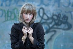 Blonde women against slums Stock Images