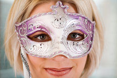 Blonde women with carnival mask Stock Photos