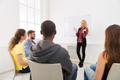 Blonde woman doing presentation in office. Blonde women doing presentation in office, copy space. Startup business meeting, sharing new ideas to partners stock image