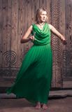 Blonde women in green dress Royalty Free Stock Photography