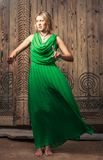 Blonde women in green dress Royalty Free Stock Photo