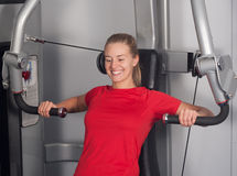Blonde women in Gym Stock Images