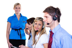 Blonde women looking at the camera. Blonde women working in a call center looking at the camera Royalty Free Stock Images