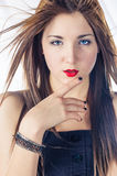 Blonde women touching her lips Stock Images