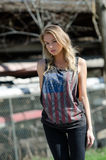 Blonde women is wearing a top featuring the stars and stripes Stock Photography