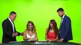 Blonde won jackpot in poker table. Brunette upset. Slow motion stock video