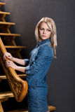 Blonde about wooden stairs Stock Photos