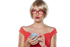 Blonde writing text message Royalty Free Stock Photos