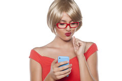 Blonde writing text message Stock Photography