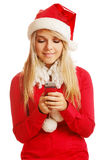 Blonde in xmas clothes. Portrait of beautiful blonde girl in xmas clothes with cellphone on white Stock Photos