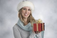 Blonde with xmas gift Stock Photos