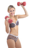 Blonde 34 years old, leopard lingerie, trains with plastic dumbb Stock Image