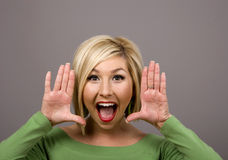 Blonde Yelling Through Hands Royalty Free Stock Photos