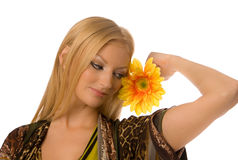 Blonde with yelllow flower isolated Royalty Free Stock Photography