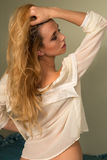Blonde in yellow. Beautiful slender Czech blonde in a pale yellow blouse Royalty Free Stock Photo