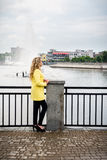 Blonde in a yellow dress against the backdrop fountain Stock Photos