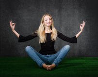 Blonde in yoga tree Stock Photography