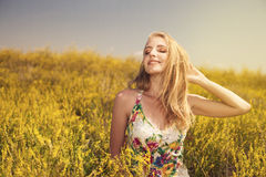 Blonde  young beautiful girl in the field photo Royalty Free Stock Image