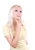 Blonde young beautiful girl thinking, isolated on Royalty Free Stock Image