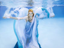 Blonde young beautiful woman as air element underwater Royalty Free Stock Photo