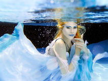 Blonde young beautiful woman as air element underwater Royalty Free Stock Image