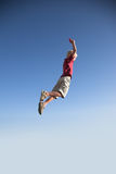 Blonde young boy jump high up Stock Photography