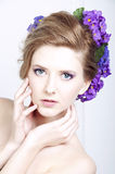 Blonde young caucasian woman with violets in her hair Royalty Free Stock Photography