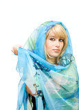 Blonde young girl with fabric Stock Image