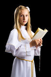 Blonde young girl in first communion Stock Photography