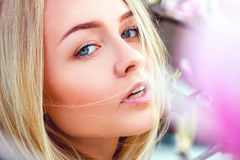 Blonde young girl looking at camera at spring time Royalty Free Stock Photography