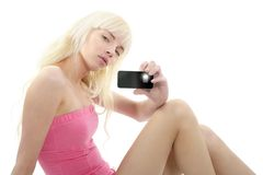 Blonde young girl portrait photo mobile phone. Beauty stock images