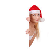 Blonde young girl in Santa hat holding white board Stock Photos