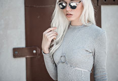 Blonde young girl in sunglassses outdoor Stock Photos