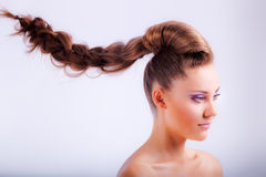 blonde young girl in whimsical coiffure hanging in air Stock Images