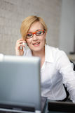 Blonde young manager calling in office Royalty Free Stock Images