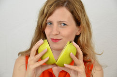 Blonde, young and sensual women with green apple cut Royalty Free Stock Photo