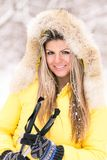 Blonde young smiling woman with ski at winter time Royalty Free Stock Photos