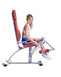 Blonde young woman ajustment exerciser isolated Stock Photo