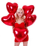 Blonde young woman with balloons for Valentines day Stock Images