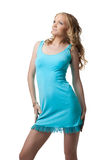 Blonde young woman in blue dress Stock Photography