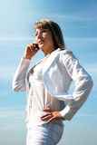Blonde young woman calling by mobile phone Stock Images