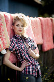 Blonde young woman in cowboy shirt and blue jeans Royalty Free Stock Photo